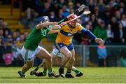9 June 2019; John Conlon of Clare in action against Mike Casey of Limerick during the Munster GAA Hurling Senior Championship Round 4 match between Limerick and Clare at the LIT Gaelic Grounds in Limerick. Photo by Diarmuid Greene/Sportsfile