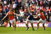 9 June 2019; Oisin Pierson of Cavan in action against James Morgan and Paul Hughes of Armagh during the Ulster GAA Football Senior Championship Semi-Final Replay match between Cavan and Armagh at St Tiarnach's Park in Clones, Monaghan. Photo by Philip Fitzpatrick/Sportsfile