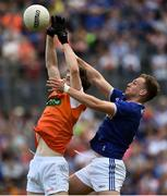 9 June 2019; Andy Murnin of Armagh in action against Padraig Faulkner of Cavan during the Ulster GAA Football Senior Championship Semi-Final Replay match between Cavan and Armagh at St Tiarnach's Park in Clones, Monaghan. Photo by Oliver McVeigh/Sportsfile