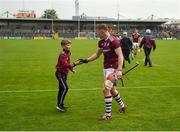 9 June 2019; Conor Whelan of Galway celebrates with supporter Jack Murray, aged 12, from Killkenard, Co Galway, after the Leinster GAA Hurling Senior Championship Round 4 match between Kilkenny and Galway at Nowlan Park in Kilkenny. Photo by Daire Brennan/Sportsfile