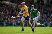 9 June 2019; Peter Duggan of Clare in action against Declan Hannon of Limerick during the Munster GAA Hurling Senior Championship Round 4 match between Limerick and Clare at the LIT Gaelic Grounds in Limerick. Photo by Diarmuid Greene/Sportsfile