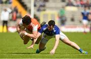 9 June 2019; James Morgan of Armagh  in action against Conor Rehill of Cavan during the Ulster GAA Football Senior Championship Semi-Final Replay match between Cavan and Armagh at St Tiarnach's Park in Clones, Monaghan. Photo by Oliver McVeigh/Sportsfile