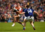 9 June 2019; Stefan Campbell of Armagh in action against Thomas Galligan of Cavan during the Ulster GAA Football Senior Championship Semi-Final Replay match between Cavan and Armagh at St Tiarnach's Park in Clones, Monaghan. Photo by Oliver McVeigh/Sportsfile