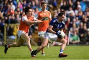 9 June 2019; Niall Murray of Cavan in action against James Morgan of Armagh during the Ulster GAA Football Senior Championship Semi-Final Replay match between Cavan and Armagh at St Tiarnach's Park in Clones, Monaghan. Photo by Oliver McVeigh/Sportsfile