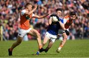 9 June 2019; Dara McVeety of Cavan in action against Rian O'Neill and Paddy Burns of Armagh during the Ulster GAA Football Senior Championship Semi-Final Replay match between Cavan and Armagh at St Tiarnach's Park in Clones, Monaghan. Photo by Oliver McVeigh/Sportsfile