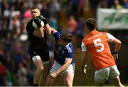 9 June 2019; Blaine Hughes of Armagh taking the ball in the air against Oisin Pierson of Cavan during the Ulster GAA Football Senior Championship Semi-Final Replay match between Cavan and Armagh at St Tiarnach's Park in Clones, Monaghan. Photo by Oliver McVeigh/Sportsfile