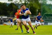 9 June 2019; Donal McElligott of Longford in action against Josh Moore of Carlow during the GAA Football All-Ireland Senior Championship Round 1 match between Carlow and Longford at Netwatch Cullen Park in Carlow. Photo by Ramsey Cardy/Sportsfile