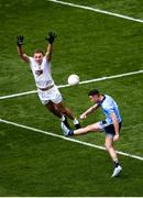 9 June 2019; Cormac Costello of Dublin kicks at the posts despite the attention of Tommy Moolick of Kildare during the Leinster GAA Football Senior Championship semi-final match between Dublin and Kildare at Croke Park in Dublin. Photo by Stephen McCarthy/Sportsfile