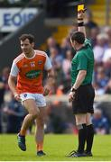 9 June 2019; Referee Paddy Neilan hands out a yellow card to Jamie Clarke of Armagh during the Ulster GAA Football Senior Championship Semi-Final Replay match between Cavan and Armagh at St Tiarnach's Park in Clones, Monaghan. Photo by Philip Fitzpatrick/Sportsfile