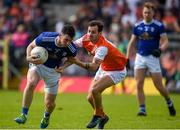 9 June 2019; Conor Rehill of Cavan in action against Jamie Clarke of Armagh during the Ulster GAA Football Senior Championship Semi-Final Replay match between Cavan and Armagh at St Tiarnach's Park in Clones, Monaghan. Photo by Philip Fitzpatrick/Sportsfile