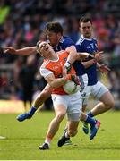 9 June 2019; Mark Shields of Armagh in action against Conor Moynagh of Cavan during the Ulster GAA Football Senior Championship Semi-Final Replay match between Cavan and Armagh at St Tiarnach's Park in Clones, Monaghan. Photo by Philip Fitzpatrick/Sportsfile