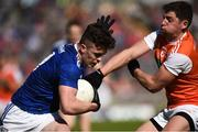 9 June 2019; Dara McVeety of Cavan in action against Paddy Burns of Armagh during the Ulster GAA Football Senior Championship Semi-Final Replay match between Cavan and Armagh at St Tiarnach's Park in Clones, Monaghan. Photo by Oliver McVeigh/Sportsfile