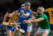 9 June 2019; Donal Tuohy of Clare in action against Cian Lynch of Limerick during the Munster GAA Hurling Senior Championship Round 4 match between Limerick and Clare at the LIT Gaelic Grounds in Limerick. Photo by Diarmuid Greene/Sportsfile