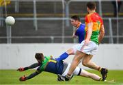 9 June 2019; Michael Quinn of Longford in action against Robert Sansom of Carlow during the GAA Football All-Ireland Senior Championship Round 1 match between Carlow and Longford at Netwatch Cullen Park in Carlow. Photo by Ramsey Cardy/Sportsfile