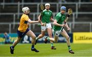 9 June 2019; Patrick Reale of Limerick in action against Colm O'Meara of Clare during the Electric Ireland Munster Minor Hurling Championship match between Limerick and Clare at the LIT Gaelic Grounds in Limerick. Photo by Diarmuid Greene/Sportsfile