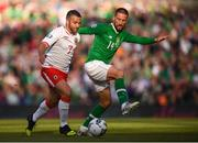 10 June 2019; Conor Hourihane of Republic of Ireland in action against Lee Casciaro of Gibraltar to the UEFA EURO2020 Qualifier Group D match between Republic of Ireland and Gibraltar at Aviva Stadium, Lansdowne Road in Dublin. Photo by Stephen McCarthy/Sportsfile