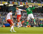 10 June 2019; Richard Keogh of Republic of Ireland in action against Jayce Olivero of Gibraltar during the UEFA EURO2020 Qualifier Group D match between Republic of Ireland and Gibraltar at the Aviva Stadium, Lansdowne Road in Dublin. Photo by Seb Daly/Sportsfile