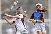 11 June 2019; Sadhbh Ní Chatháin of Gaelscoil na Camógie, Cluain Dolcáin, Dublin in action against Orla Dunne of Scoil Mhuire NS, Woodview, Dublin during the Allianz Cumann na mBunscol Finals 2019 Croke Park in Dublin. Photo by Eóin Noonan/Sportsfile
