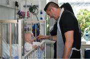 12 June 2019; EURO 2020 Ambassador Robbie Keane meets Maggie O'Donovan, aged 15 months, from Dublin, during the EURO 2020 Ambassador Robbie Keane's visit to Children's Health Ireland at Crumlin in Dublin. Photo by Harry Murphy/Sportsfile