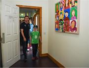 12 June 2019; EURO 2020 Ambassador Robbie Keane is walked through the ward by Peter Cullinan, aged 10, from Dublin, during the EURO 2020 Ambassador Robbie Keane's visit to Children's Health Ireland at Crumlin in Dublin. Photo by Harry Murphy/Sportsfile
