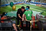 12 June 2019; EURO 2020 Ambassador Robbie Keane cuts the ribbon of the FAI Fanzone with Danny Quinsey, left, aged 7 from Enniscorthy, Co. Wexford, and Peter Cullinan, aged 10, from Dublin during the EURO 2020 Ambassador Robbie Keane's visit to Children's Health Ireland at Crumlin in Dublin. Photo by Harry Murphy/Sportsfile