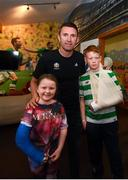 12 June 2019; EURO 2020 Ambassador Robbie Keane with Caitlin King, aged 8, from Dublin and Cian Larsson, aged 13, from Dublin, during the EURO 2020 Ambassador Robbie Keane's visit to Children's Health Ireland at Crumlin in Dublin. Photo by Harry Murphy/Sportsfile