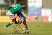 12 June 2019; Ben Healy of Ireland is tackled during the World Rugby U20 Championship Pool B match between Ireland and Italy at Club De Rugby Ateneo Inmaculada, Santa Fe in Argentina. Photo by Florencia Tan Jun/Sportsfile