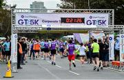 12 June 2019; Competitors cross the finish line during the Grant Thornton Corporate 5K Team Challenge, Cork City, The South Mall in Cork City. Photo by Piaras Ó Mídheach/Sportsfile