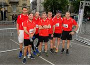 12 June 2019; Cumnor Construction Limited runners, from left, Michael O'Mahony, Eamonn O'Mahony, Mike Varian, Cian O'Mahony, Anthony Ahern, Kieran Crean and Damian O'Connor before the Grant Thornton Corporate 5K Team Challenge, Cork City, The South Mall in Cork City. Photo by Piaras Ó Mídheach/Sportsfile