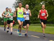 15 June 2019; Eddie Mcgrath of Liffey Valley A.C., Co. Dublin, centre and Brian Martin, right, compete during the Irish Runner 5 Mile in conjunction with the AAI National 5 Mile Championships at the Phoenix Park in Dublin. Photo by Harry Murphy/Sportsfile