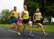 15 June 2019; Eamon White of North Belfast Harriers, centre, Mark Pearce of Brothers Pearse A.C., Co. Dublin, left, and Philip Goss of North Belfast Harriers, right, compete during the Irish Runner 5 Mile in conjunction with the AAI National 5 Mile Championships at the Phoenix Park in Dublin. Photo by Harry Murphy/Sportsfile