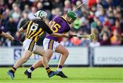 15 June 2019; Pádraig Walsh of Kilkenny knocks the ball away from Conor McDonald of Wexford as he prepares to shoot for goal in the first half during the Leinster GAA Hurling Senior Championship Round 5 match between Wexford and Kilkenny at Innovate Wexford Park in Wexford. Photo by Piaras Ó Mídheach/Sportsfile