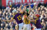 15 June 2019; Joey Holden of Kilkenny gathers possession under pressure from Cathal Dunbar, left, and Lee Chin of Wexford during the Leinster GAA Hurling Senior Championship Round 5 match between Wexford and Kilkenny at Innovate Wexford Park in Wexford. Photo by Piaras Ó Mídheach/Sportsfile