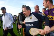 15 June 2019; Wexford manager Davy Fitzgerald reacts after he found out they qualified for the Final, alongside Matthew O'Hanlon, after the Leinster GAA Hurling Senior Championship Round 5 match between Wexford and Kilkenny at Innovate Wexford Park in Wexford. Photo by Piaras Ó Mídheach/Sportsfile
