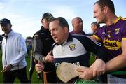15 June 2019; Wexford manager Davy Fitzgerald reacts after he found out they qualified for the Final, alongside Matthew O'Hanlon, and Kilkenny manager Brian Cody, behind, after the Leinster GAA Hurling Senior Championship Round 5 match between Wexford and Kilkenny at Innovate Wexford Park in Wexford. Photo by Piaras Ó Mídheach/Sportsfile
