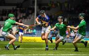16 June 2019; Stephen Ferncombe of Tipperary in action against Adam Murrihy, Ronan Lyons and Fergal O'Connor, right, of Limerick during the Electric Ireland Munster GAA Minor Hurling Championship Round 5 match between Tipperary and Limerick in Semple Stadium, Thurles, in Tipperary. Photo by Ray McManus/Sportsfile