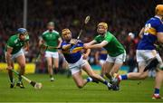 16 June 2019; Seamus Callanan of Tipperary passes to team mater Jake Morris under pressure feom Richie English and James Barry of Tipperary, left, during the Munster GAA Hurling Senior Championship Round 5 match between Tipperary and Limerick in Semple Stadium in Thurles, Tipperary. Photo by Ray McManus/Sportsfile
