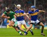 16 June 2019; Paddy O'Loughlin of Limerick in action against John McGrath and Michael Breen of Tipperary  during the Munster GAA Hurling Senior Championship Round 5 match between Tipperary and Limerick in Semple Stadium in Thurles, Tipperary. Photo by Ray McManus/Sportsfile