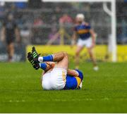 16 June 2019; Patrick Maher of Tipperary lies injured during the Munster GAA Hurling Senior Championship Round 5 match between Tipperary and Limerick in Semple Stadium in Thurles, Tipperary. Photo by Ray McManus/Sportsfile