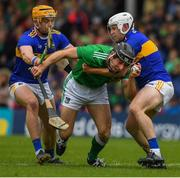 16 June 2019; Pat Ryan of Limerick in action against Sean O'Brien and Ronan Maher of Tipperary during the Munster GAA Hurling Senior Championship Round 5 match between Tipperary and Limerick in Semple Stadium in Thurles, Tipperary. Photo by Ray McManus/Sportsfile