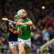 16 June 2019; Cian Lynch of Limerick scores the last point of the game under pressure from Noel McGrath of Tipperary during the Munster GAA Hurling Senior Championship Round 5 match between Tipperary and Limerick in Semple Stadium in Thurles, Tipperary. Photo by Ray McManus/Sportsfile