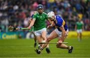 16 June 2019; Padraic Maher of Tipperary  in action against David Reidy of Limerick  during the Munster GAA Hurling Senior Championship Round 5 match between Tipperary and Limerick in Semple Stadium in Thurles, Tipperary. Photo by Ray McManus/Sportsfile