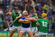 16 June 2019; Padraic Maher of Tipperary  in action against Conor Boylan, left, and Graeme Mulcahy and Tom Morrissey, 12, of Limerick during the Munster GAA Hurling Senior Championship Round 5 match between Tipperary and Limerick in Semple Stadium in Thurles, Tipperary. Photo by Ray McManus/Sportsfile