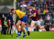 16 June 2019; Enda Smith of Roscommon in action against Johnny Heaney of Galway during the Connacht GAA Football Senior Championship Final match between Galway and Roscommon at Pearse Stadium in Galway. Photo by Seb Daly/Sportsfile