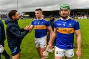 16 June 2019; Tipperary Strength and Conditioning Coach Cairbre Ó Cairealláin with Padraic Maher and Noel McGrath of Tipperary after the Munster GAA Hurling Senior Championship Round 5 match between Tipperary and Limerick in Semple Stadium in Thurles, Co. Tipperary. Photo by Diarmuid Greene/Sportsfile