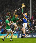 16 June 2019; Jake Morris of Tipperary in action against Richie English, 4, and William O'Donoghue of Limerick during the Munster GAA Hurling Senior Championship Round 5 between Tipperary and Limerick in Semple Stadium in Thurles, Tipperary. Photo by Ray McManus/Sportsfile