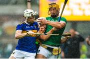 16 June 2019; Tom Morrissey of Limerick is shouldered over the sideline by Brendan Maher and Sean O'Brien of Tipperary during the Munster GAA Hurling Senior Championship Round 5 match between Tipperary and Limerick in Semple Stadium in Thurles, Co. Tipperary. Photo by Diarmuid Greene/Sportsfile
