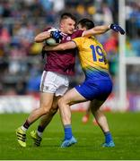 16 June 2019; Eoghan Kerin of Galway in action against Hubert Darcy of Roscommon during the Connacht GAA Football Senior Championship Final match between Galway and Roscommon at Pearse Stadium in Galway. Photo by Ramsey Cardy/Sportsfile