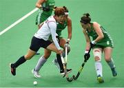 16 June 2019; Lee Seungju of Korea in action against Sarah Hawkshaw and Roisin Upton of Ireland during the FIH World Hockey Series Final match between Ireland and Korea at Banbridge Hockey Club in Banbridge, Down.  Photo by Oliver McVeigh/Sportsfile