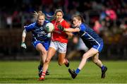 16 June 2019; Orla Finn of Cork in action against Emma Murray, right, and  Máiréad Wall of Waterford during the TG4 Ladies Football Munster Senior Football Championship Final match between Cork and Waterford at Fraher Field in Dungarvan, Co. Waterford. Photo by Harry Murphy/Sportsfile